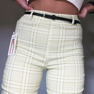 Green and white plaid pants
